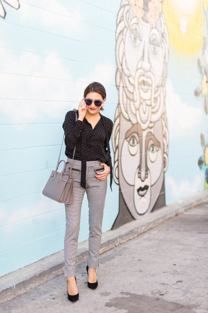 Lifestyle and Corporate blogger Amanda Warsavsky wearing Veronica Beard check pants and a Banana Republic dot blouse