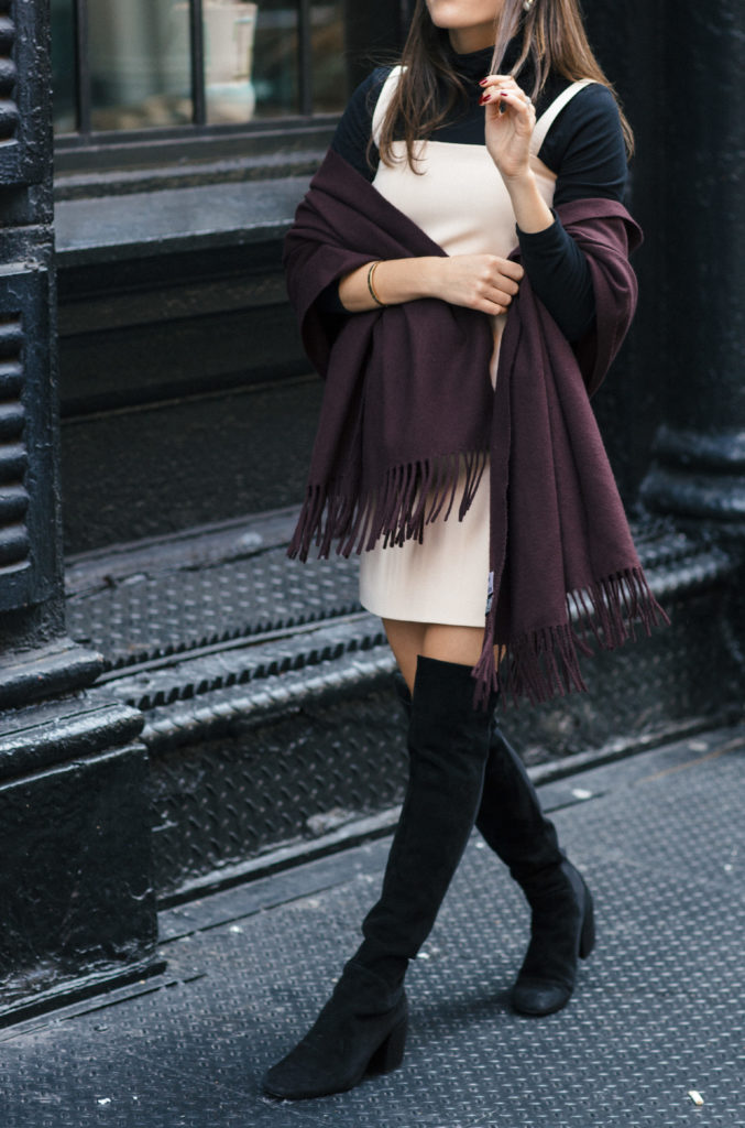 Lifestyle and corporate blogger That Pencil Skirt wearing a cream helmut lang jumper, black turtleneck, and wine scarf