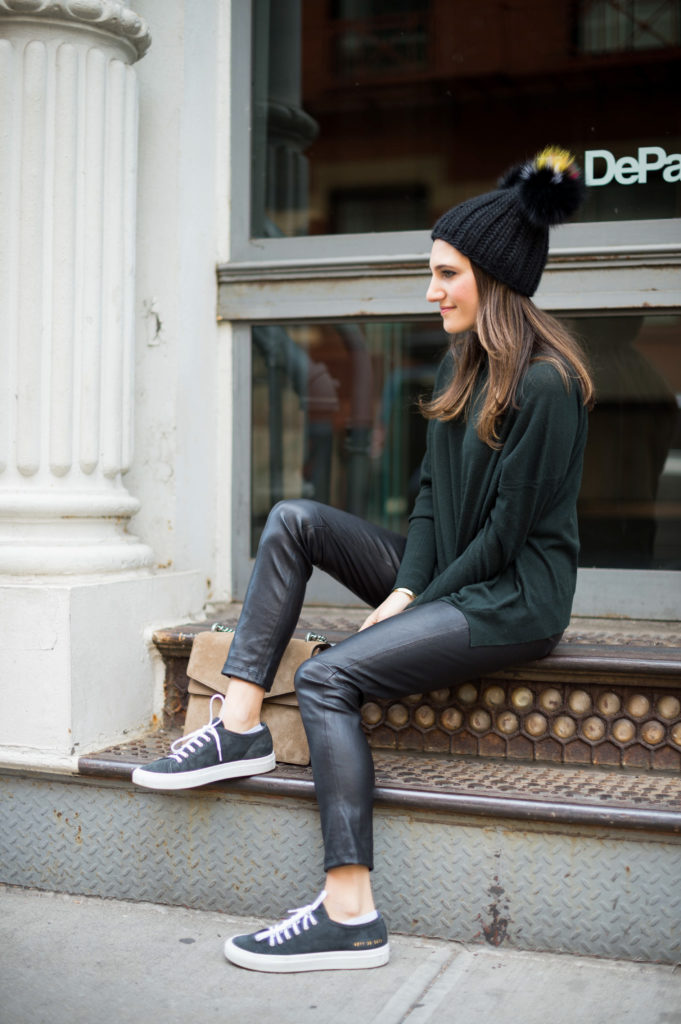 Lifestyle blogger Amanda Warsavsky wearing a J Brand turtleneck sweater, leather leggings, Common Projects sneakers and Eugina Kim hat