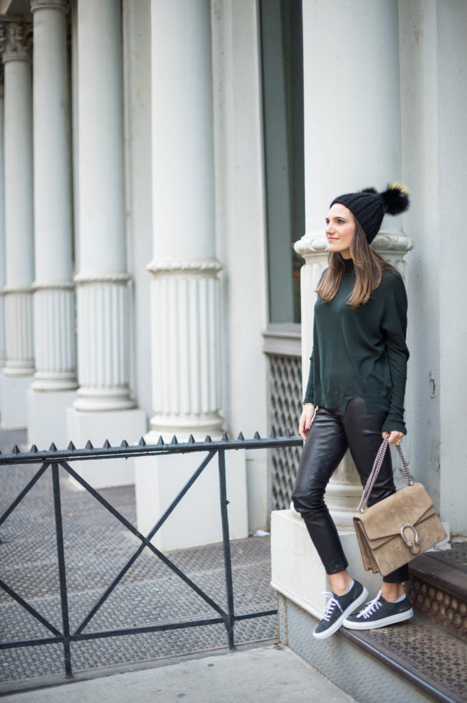 Lifestyle blogger That Pencil Skirt wearing a J Brand turtleneck sweater, leather leggings, Common Projects sneakers, Gucci bag and Eugina Kim hat
