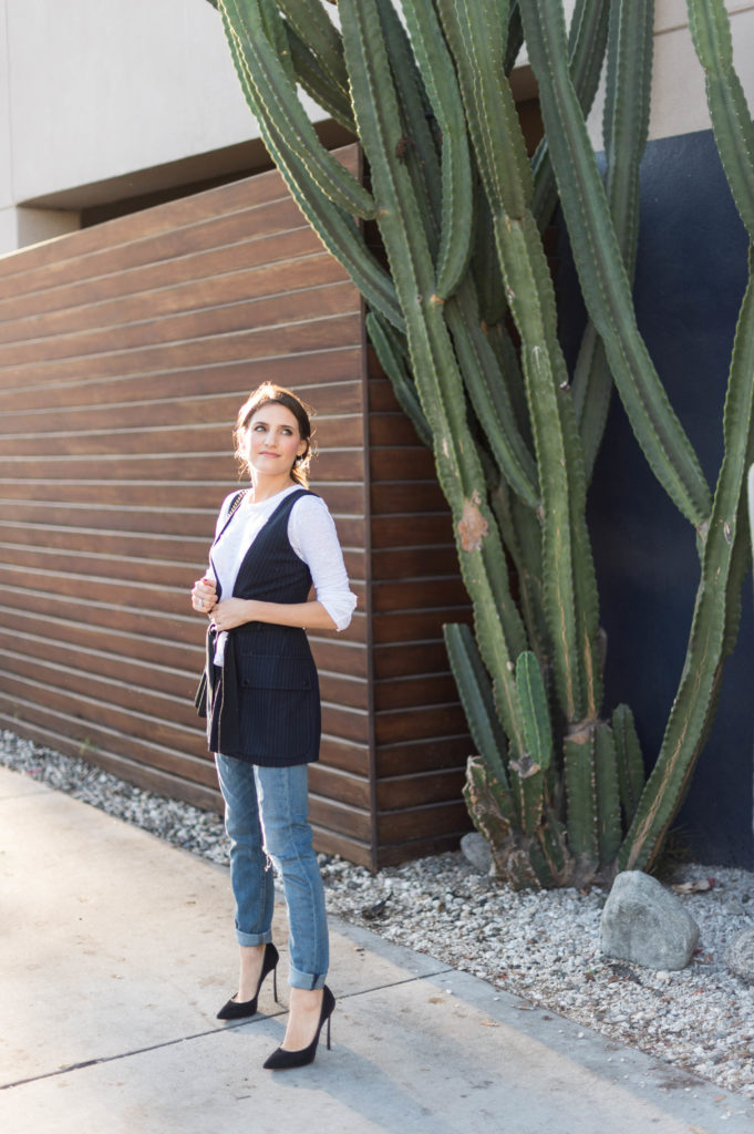 Lifestyle and corporate blogger That Pencil Skirt wearing a Marisa Webb vest and Rag and Bone boyfriend jeans