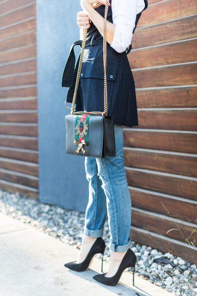 Lifestyle and corporate blogger That Pencil Skirt wearing a Marisa Webb vest and Rag, Bone boyfriend jeans, and a Gucci purse