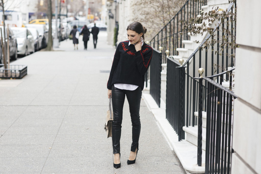 Lifestyle and corporate blogger That Pencil Skirt wearing leather pants, a Cinq a Sept sweater, white button down blouse and Gucci bag