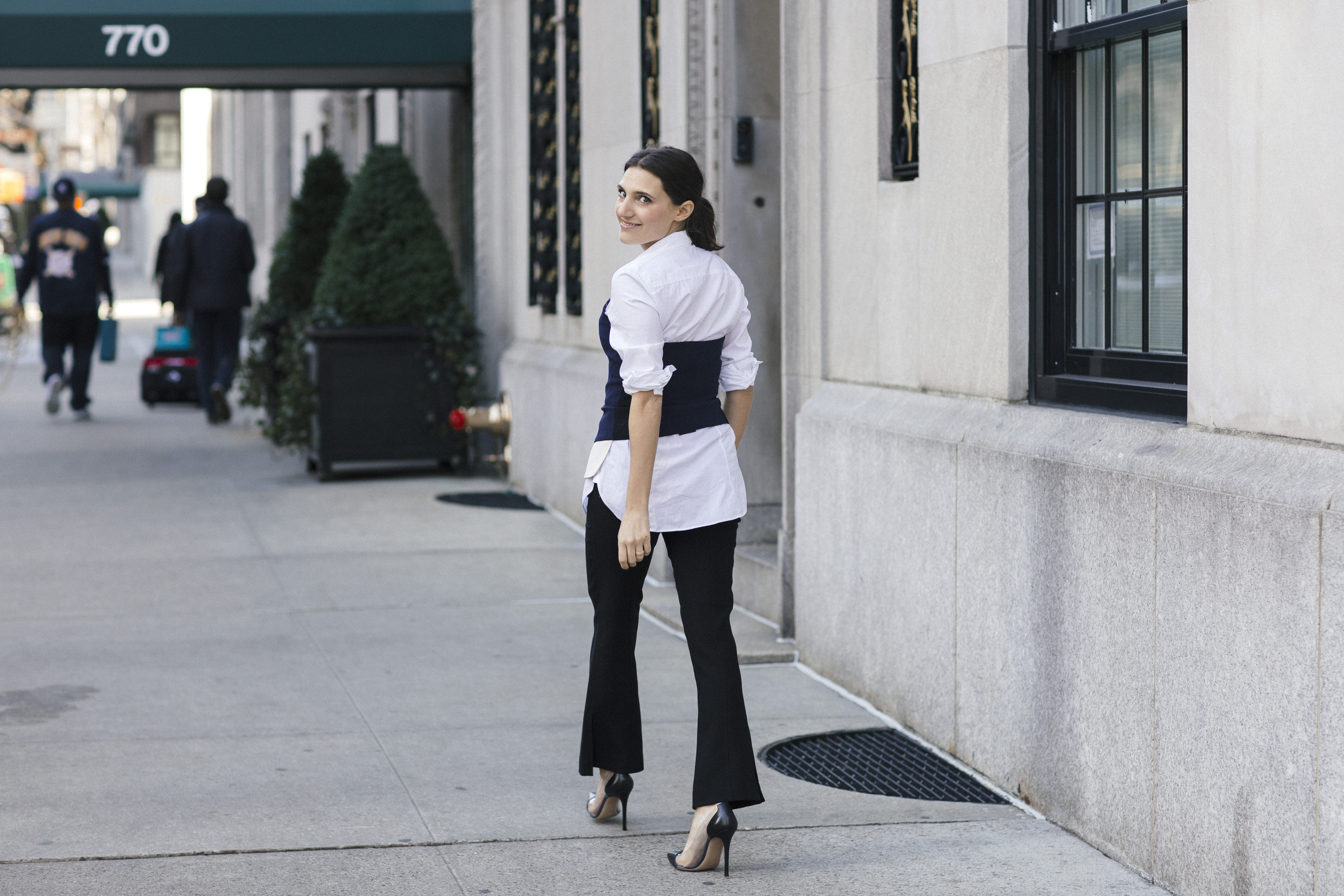 lifestyle blogger That Pencil Skirt wearing crop flare black pants, a white button down top and a laveer bustier