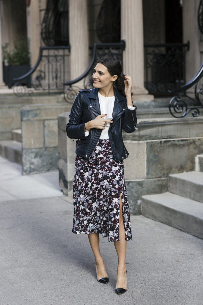 Corporate blogger Amanda Warsavsky wearing a Veronica Beard a line midi skirt, white ruffle top, Gianvito Rossi pumps and and Iro navy leather jacket