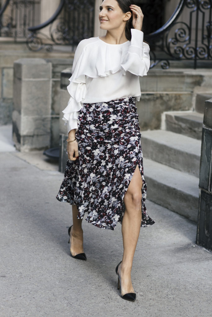 Corporate blogger Amanda Warsavsky wearing a Veronica Beard a line midi skirt, white ruffle top, and Gianvito Rossi leather and plexipumps