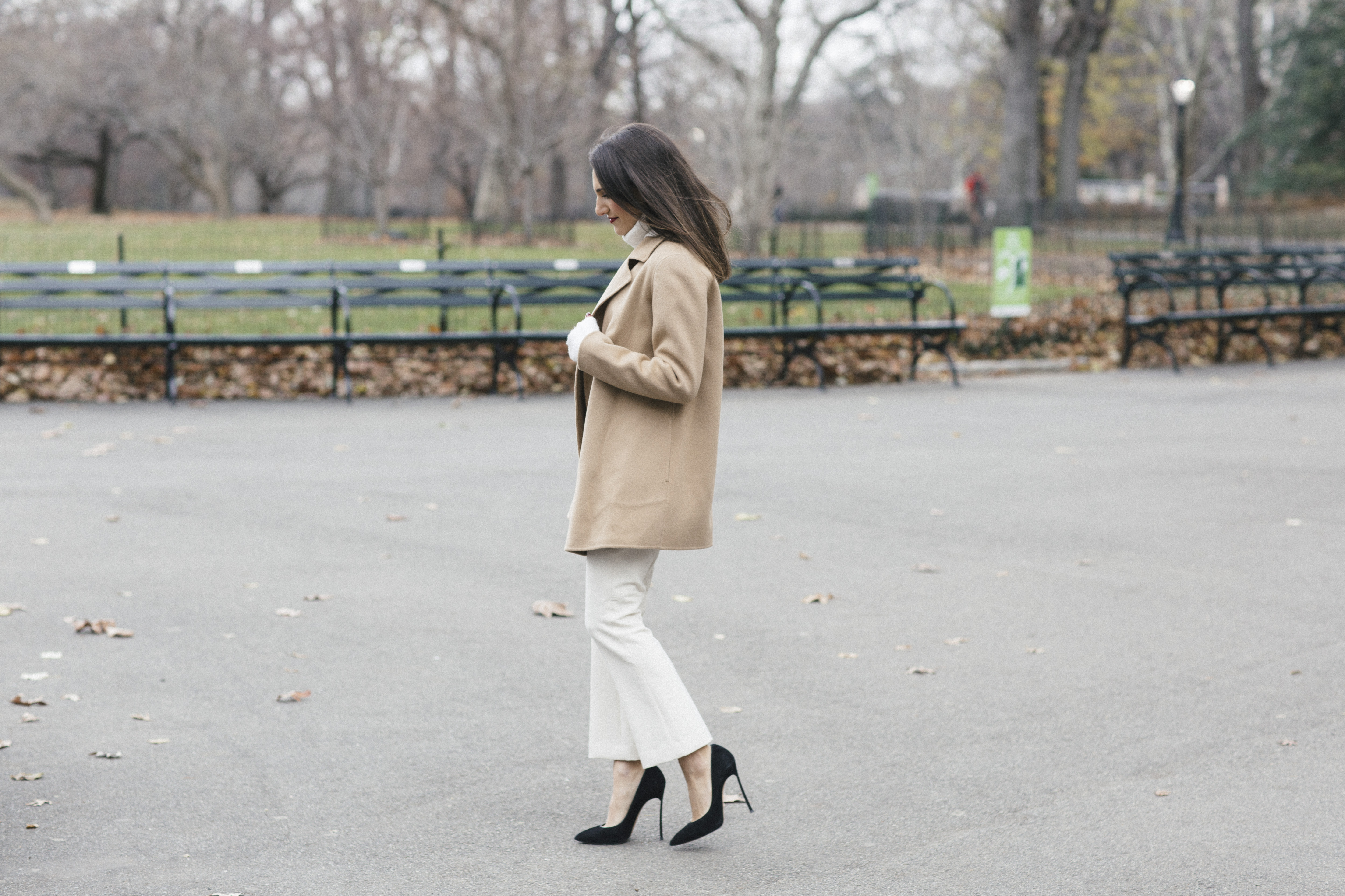 Corporate blogger That Pencil Skirt wearing winter white theory pants, a white turtleneck and a tan open cashmere coat