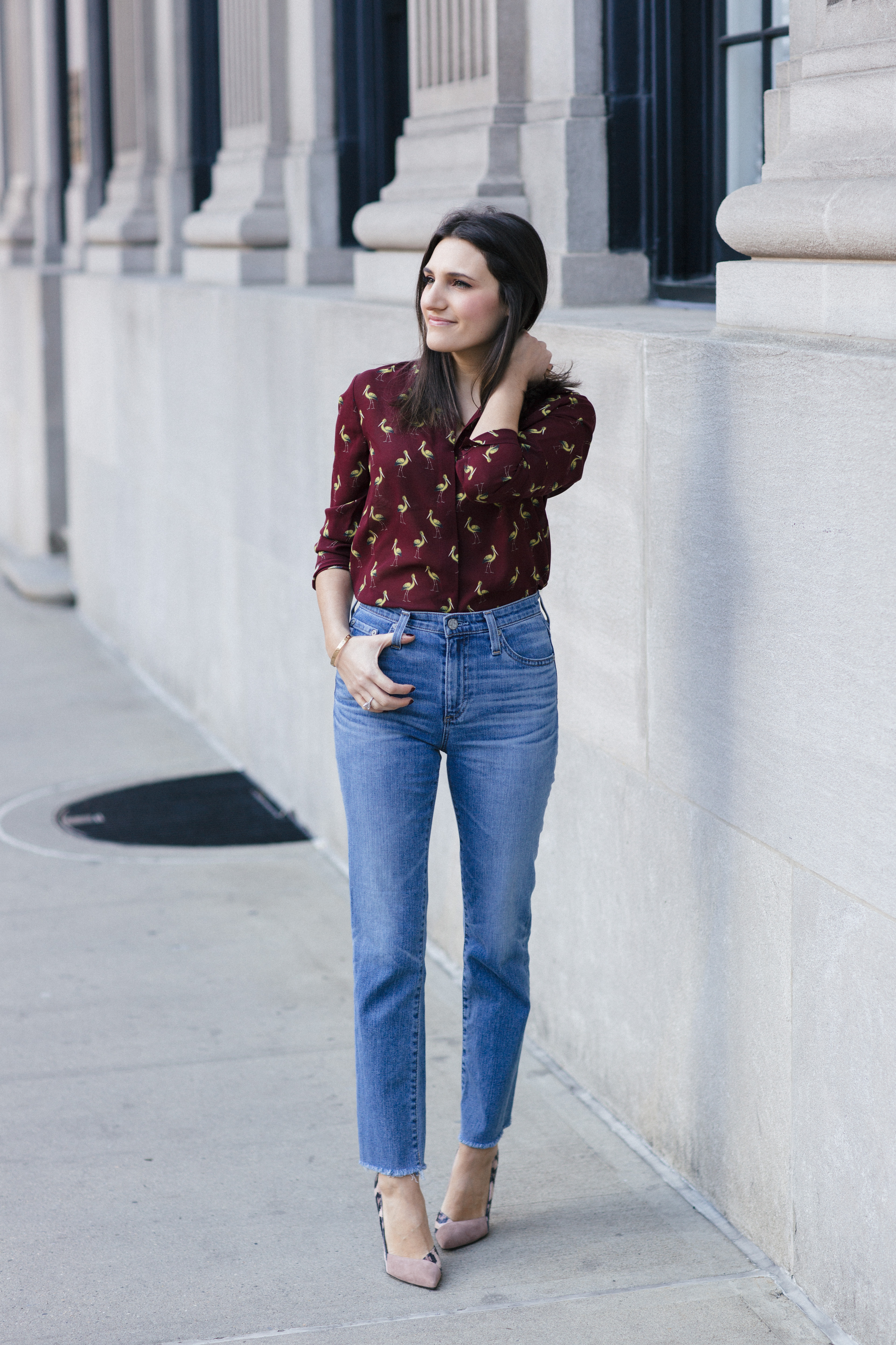 Amanda Warsavsky wearing an Alice and Olivia blouse, AG jeans and Sergio Rossi pumps discusisng challenges with fertility treatments