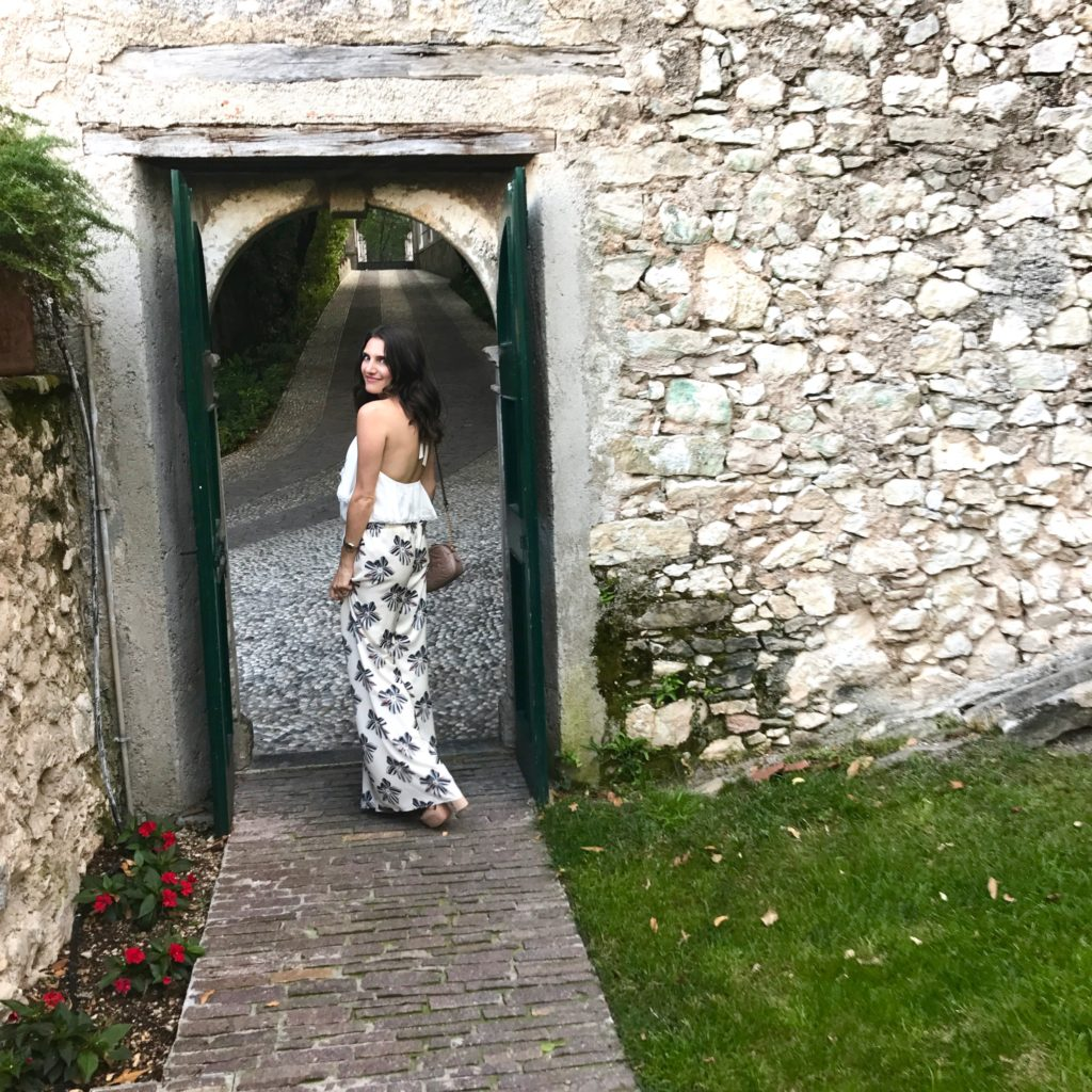 That Pencil Skirt wearing Alexis Silk pants and an Alice and Olivia halter top in Lake Garda