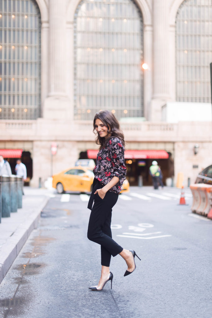 Lifestyle and work style blogger That Pencil Skirt wearing a black printed floral ba&sh blouse and tie waist black trousers