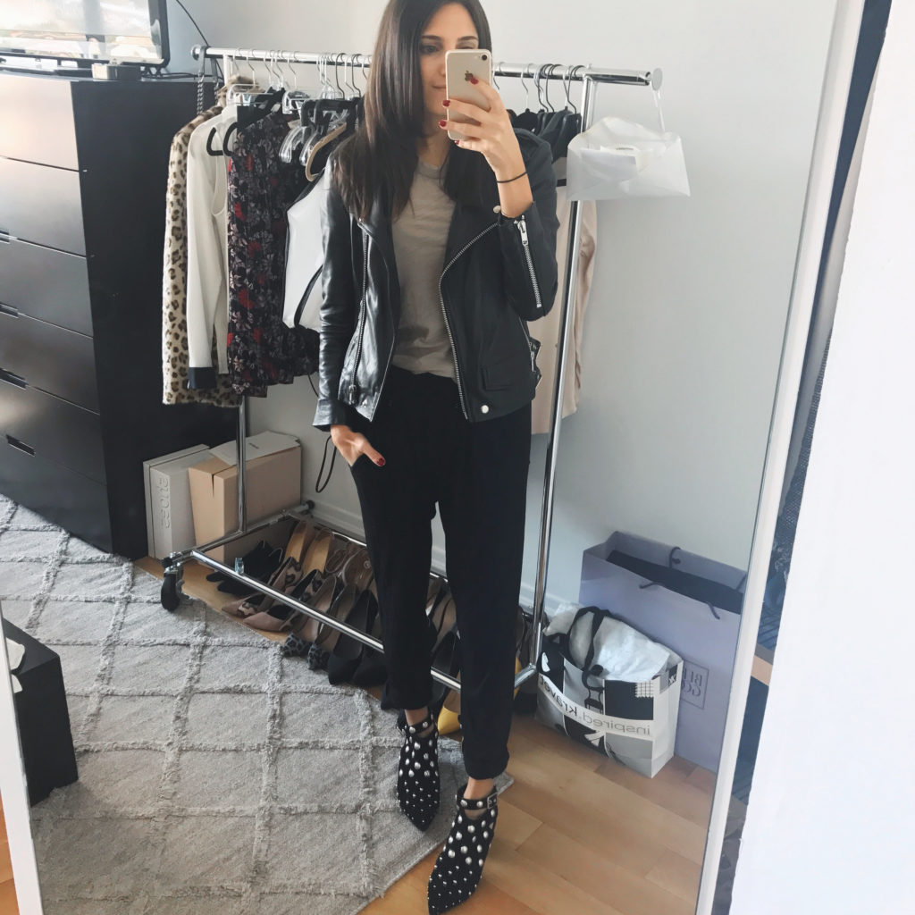 Work style blogger That Pencil Skirt wearing an inexpensive Oak real leather jacket, Topshop studded open back booties, and black jogger pants.