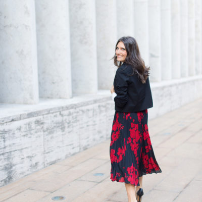 Lifestyle and work wear inspiration blogger That Pencil Skirt wearing a H&M red and navy pleated midi skirt and Gianvito Rossi plexi and black leather pump and a Ba&sh crop black blazer