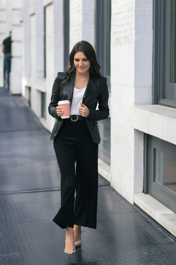Lifestyle and work wear blogger That Pencil Skirt wearing a Theory peplum leather jacket, Miu Miu embellished belt and wide leg black pants