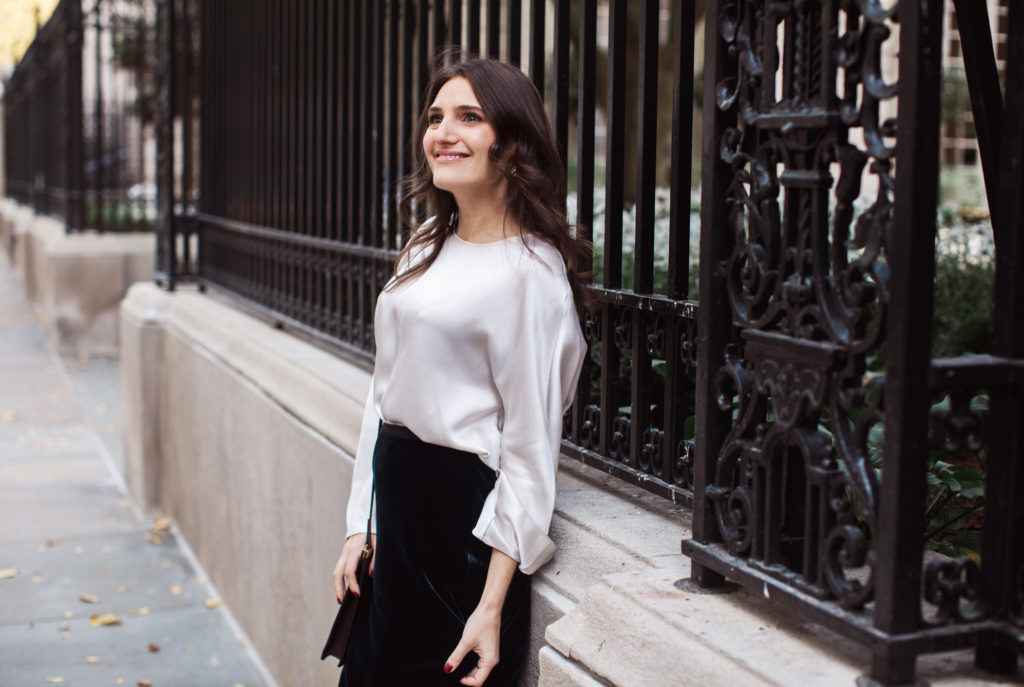 That Pencil Skirt, a lifestyle and workwear blogger wearing a Vince Velvet midi skirt with a Vince silk silver blouse