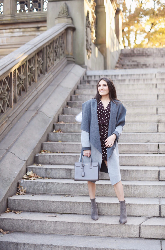 That Pencil Skirt, a lifestyle and work wear blogger, wearing a Soia and Kyo gray wrap coat with a fur hood, and Jimmy Choo gray sock ankle boots
