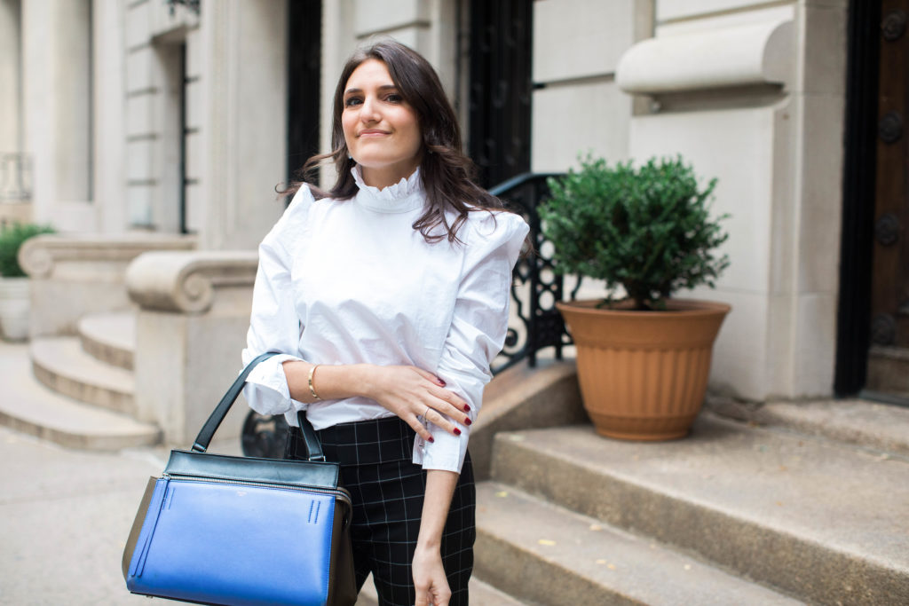 Lifestyle and workwear blogger That Pencil Skirt wearing a Frame ruffle collar Victorial blouse, Alice and Olicia Stacy windowpane pants, a Celine bag and black suede pointed toe Jimmy Choo pumps