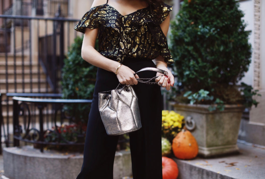 Lifestyle and work wear inspiration blogger That Pencil Skirt wearing a Veronica Beard metallic off the shoulder top with wide leg crop black trousers and a jerome dreyfus silver popeye bucket bag