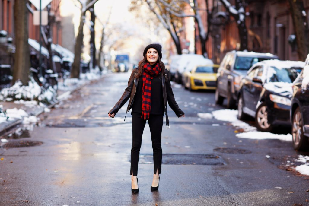 That Pencil Skirt, a lifestyle blogger, wearing Ann Taylor maternity friendly leggins with a front slit, a red and blue check scarf and a pom pom hat